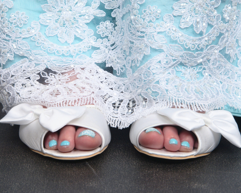 Azure Elizabeth wearing white sandals with blue nails and blue wedding dress covered with white lace
