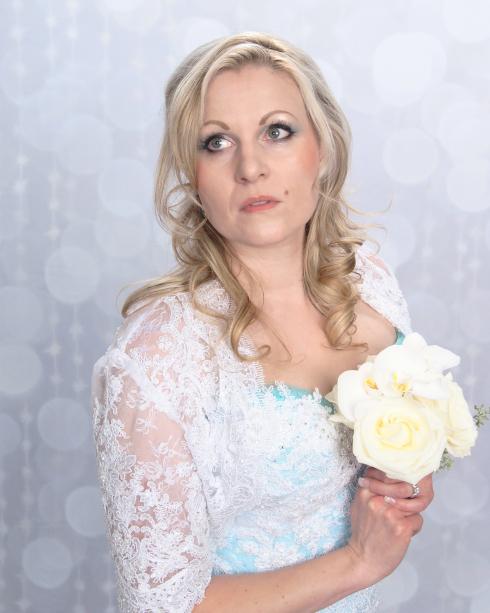 Azure Elizabeth holding a white roses