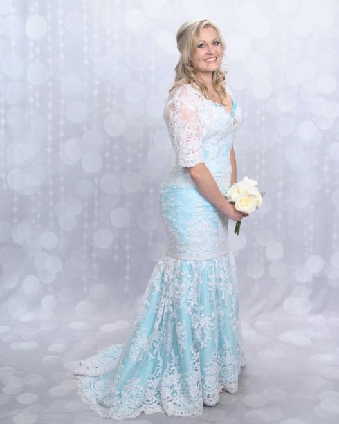 Azure Elizabeth wearing her wedding dress with her beautiful smile