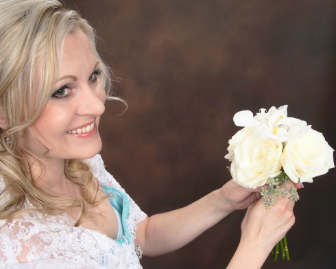 Azure Elizabeth holding a white roses with her beautiful smile