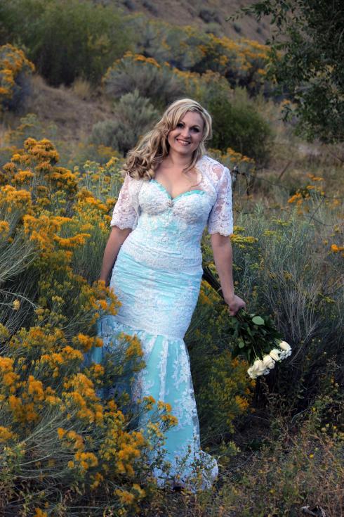 Azure Elizabeth on a yellow sage field wearing her wedding dress