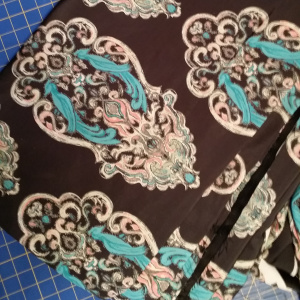 Bird design on color brown fabric