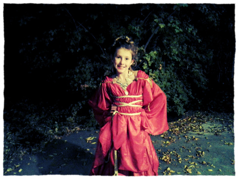 A Happy daughter of Azure Elizabeth wearing red and gold aphrodite costume