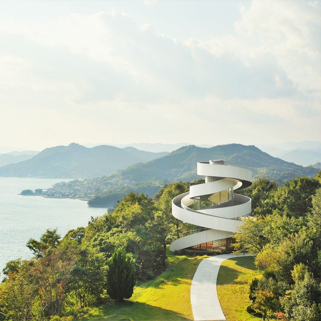Ribbon Chapel surrounded by green landscape and ocean