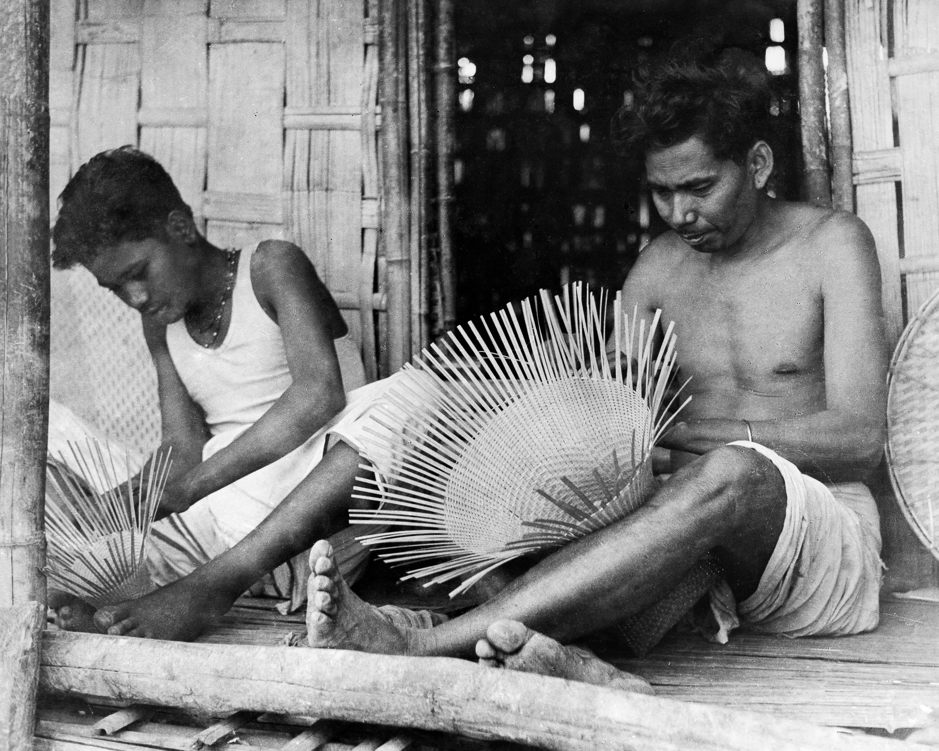 Wa Wo , meaning 'Bamboo Making', refers to basketry craft and is the role of men in indigenous communities in Tripura.  c.1977