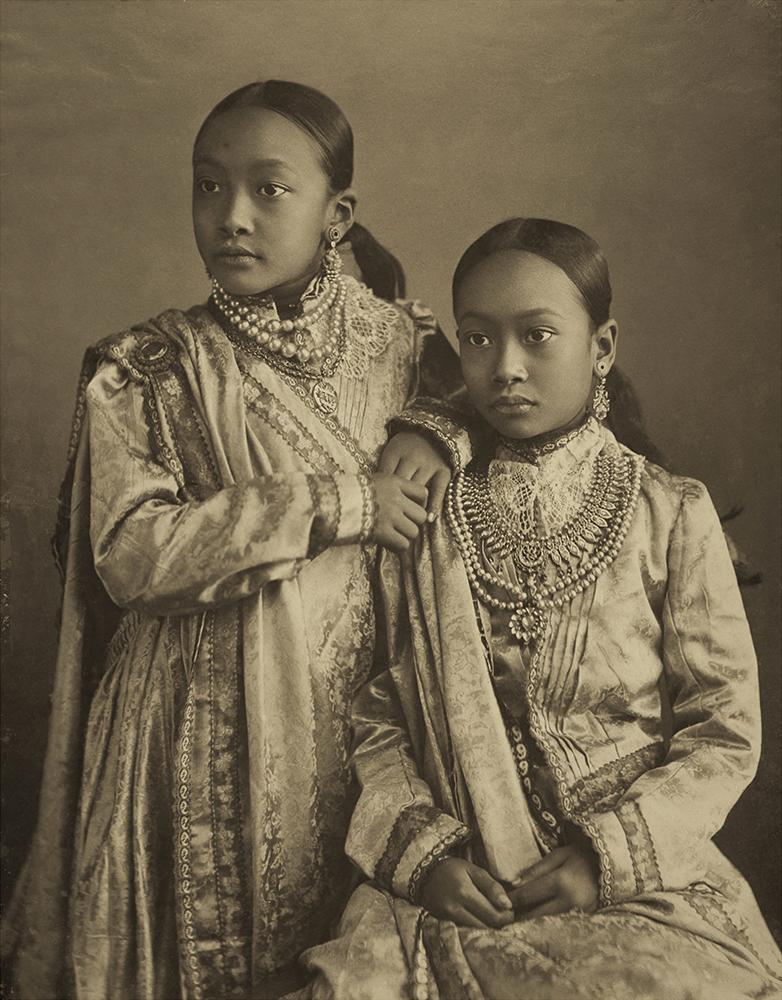 Princesses Kumudini (left) and Nalini (seated right), daughters of Monmohini Devi, in formal Indian costume with European influences. Photographed by Bir Chandra Manikya. Platinum palladium print.  c. 1890.