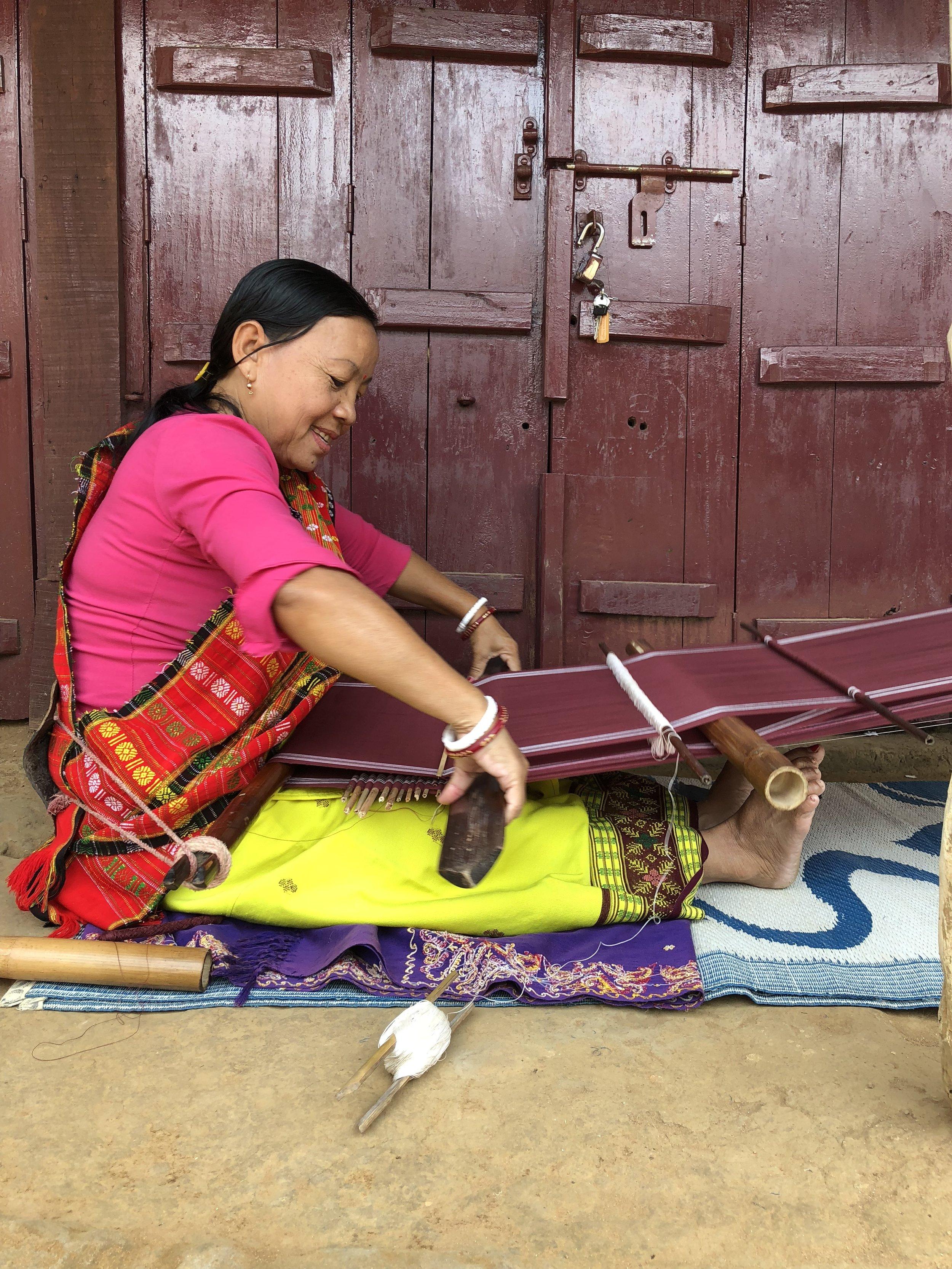 Sandhya, a weaver from Lefunga Village, Tripura, weaving a Risha on her backstrap loom.  2018