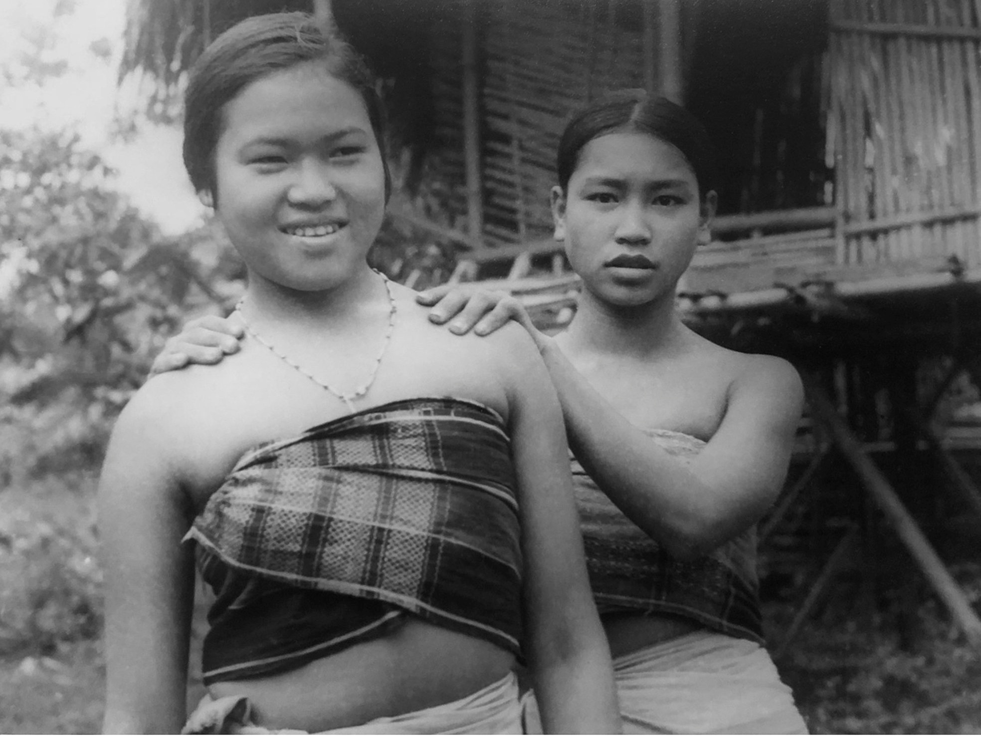 Two girls from the Deb Barma community wearing their traditional Risha.  c.1974