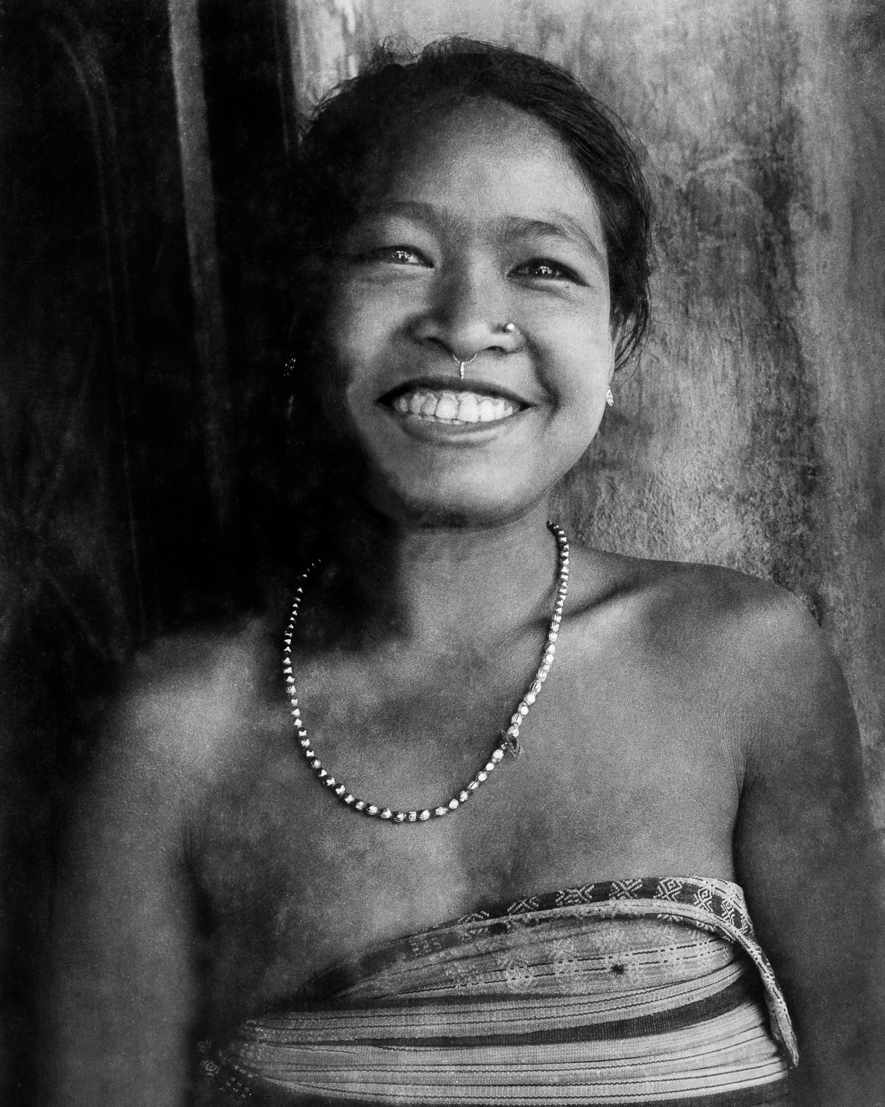 Deb Barma girl wearing a risha and  ganthi bwtang ,  ganthi  meaning beads and  bwtang  meaning necklace.  c.1974