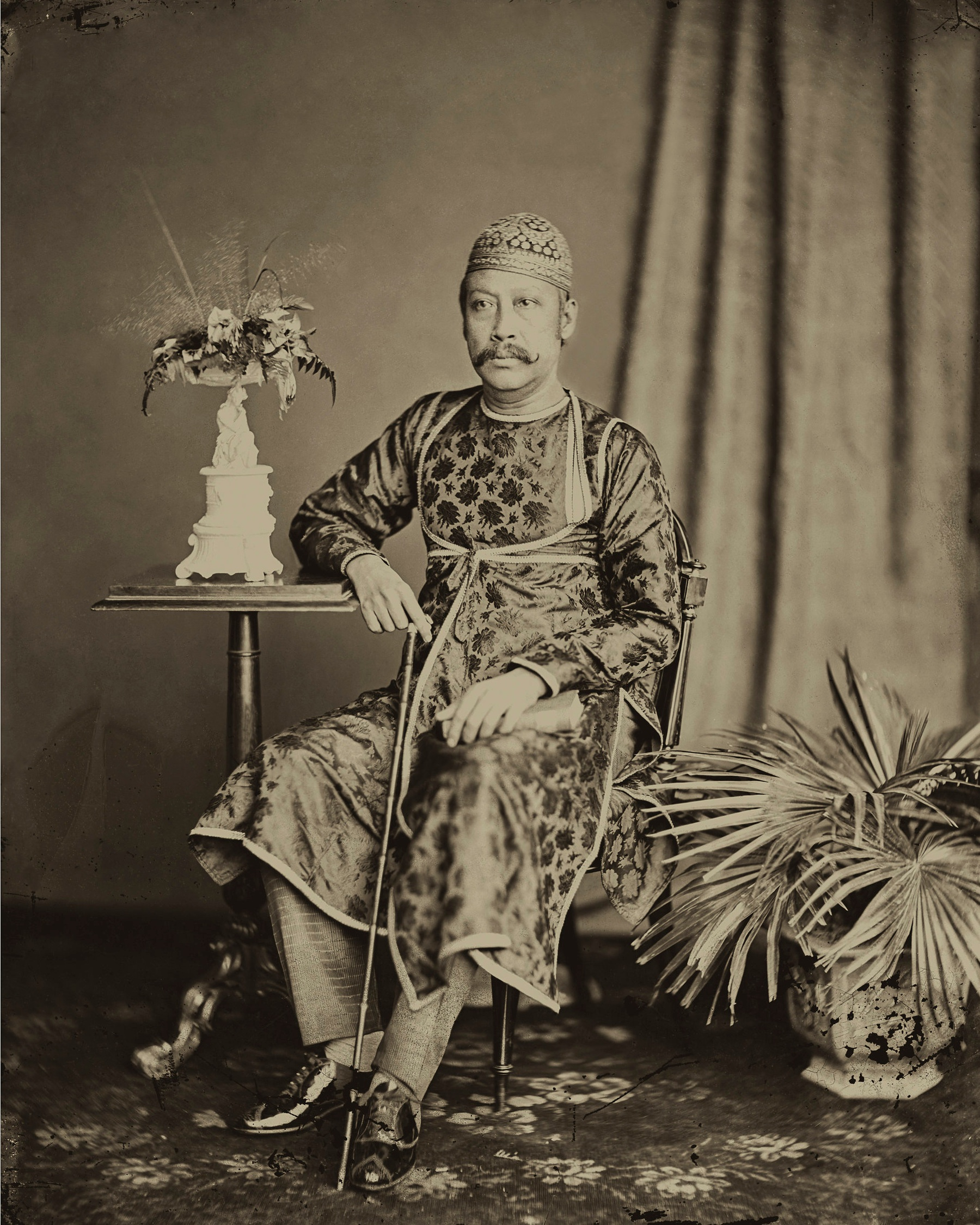 Raja Bir Chandra Manikya. The king is wearing an angarakha of patterned silk, with a chest opening covered with an inner flap or purdah tied at the waist.  c.1880 . Platinum palladium print