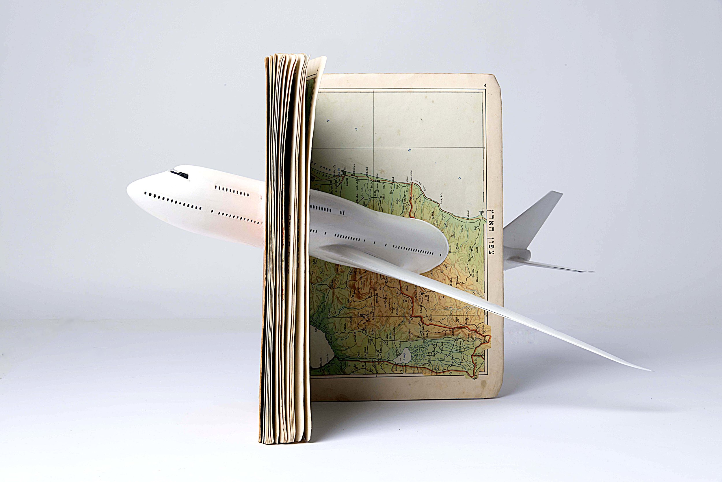 Air-Atlas, 2018, Atlas, Airplane Model, 50X50X50 cm. From the exhibition: The Map: Reading Between the Lines, 2018, MUSA Eretz Israel Museum, Tel-Aviv. Curator: Batia Donner