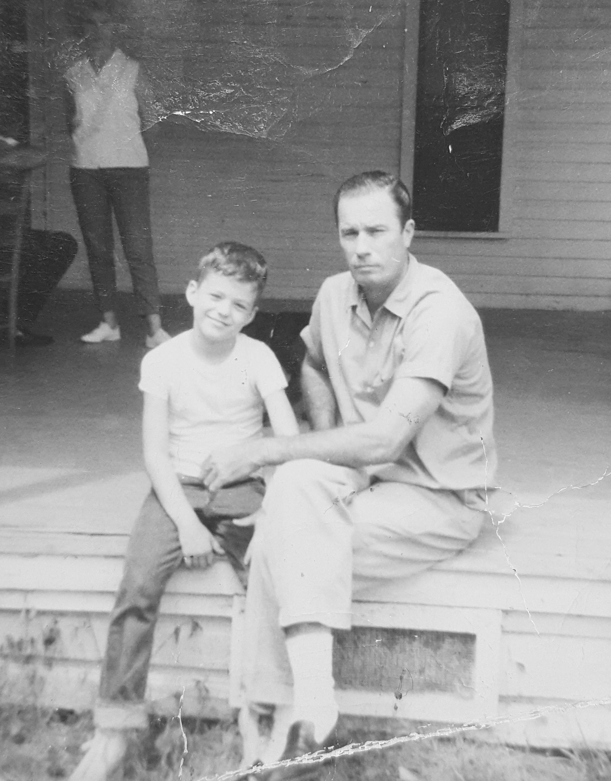 Mark Wynn as a boy with his stepfather