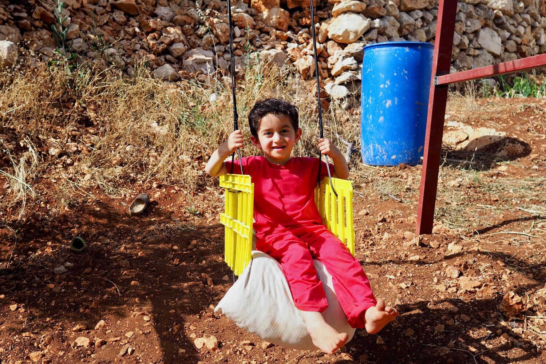 Mahmoud, the little man of the house, was a ball of energy © Sarah Reid