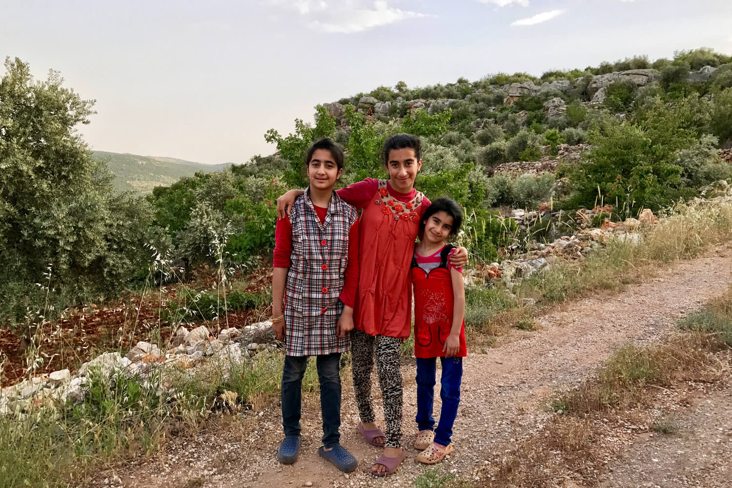 Maysoon's daughters take me for a walk through the olive groves as our dinner was cooking © Sarah