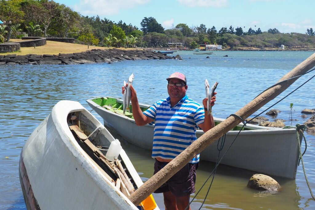 A local fisherman shows off his morning's catch © Sarah Reid