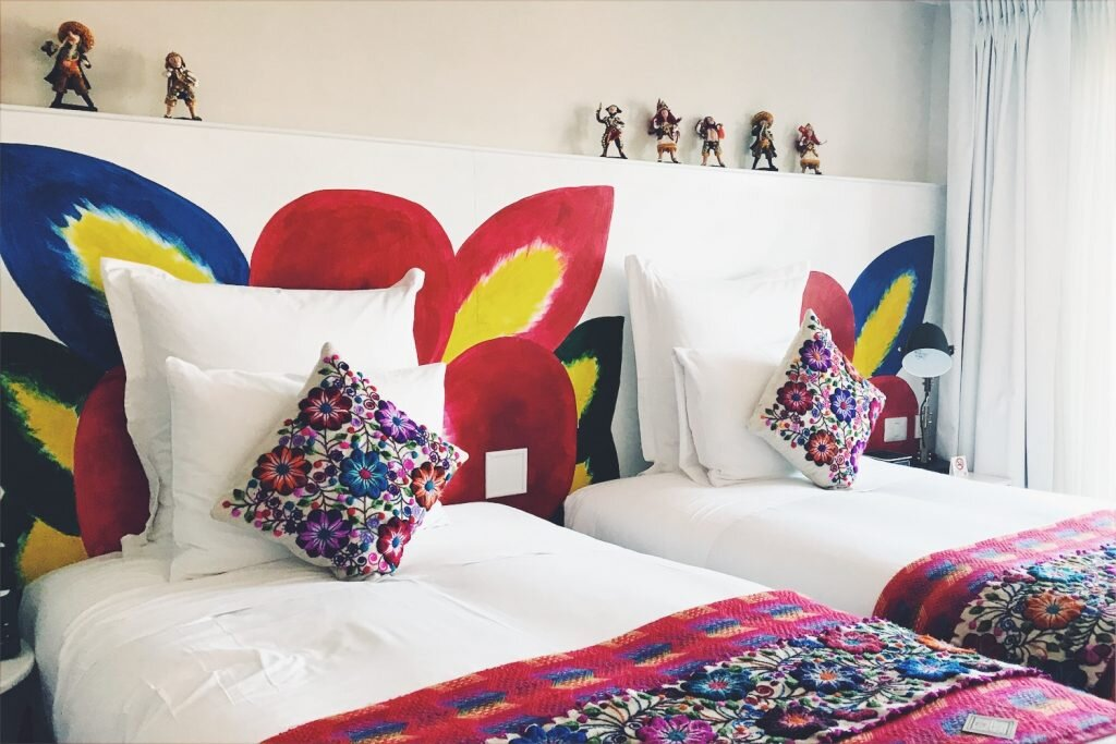 Rooms are furnished with luxe traditional textiles and folk art © Sarah Reid