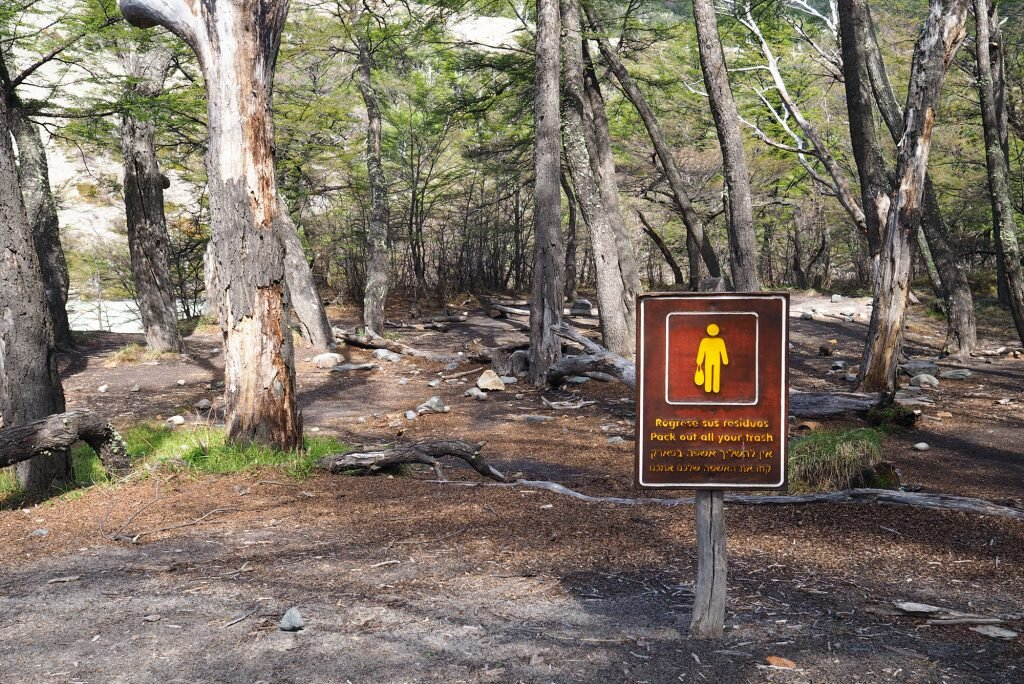 It's a shame that hikers need to be told (in three languages) to clean up after themselves © Sarah Reid