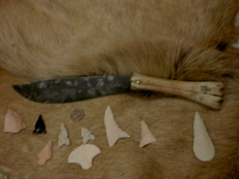 Primitive knife with mustard patina and bone handle, and some stone points