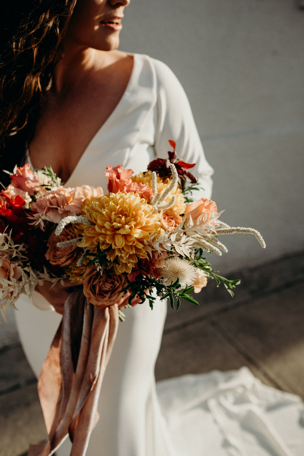 bride holding bright summer custom arrangement by elizabeth mckenzie for photography collaboration.jpg