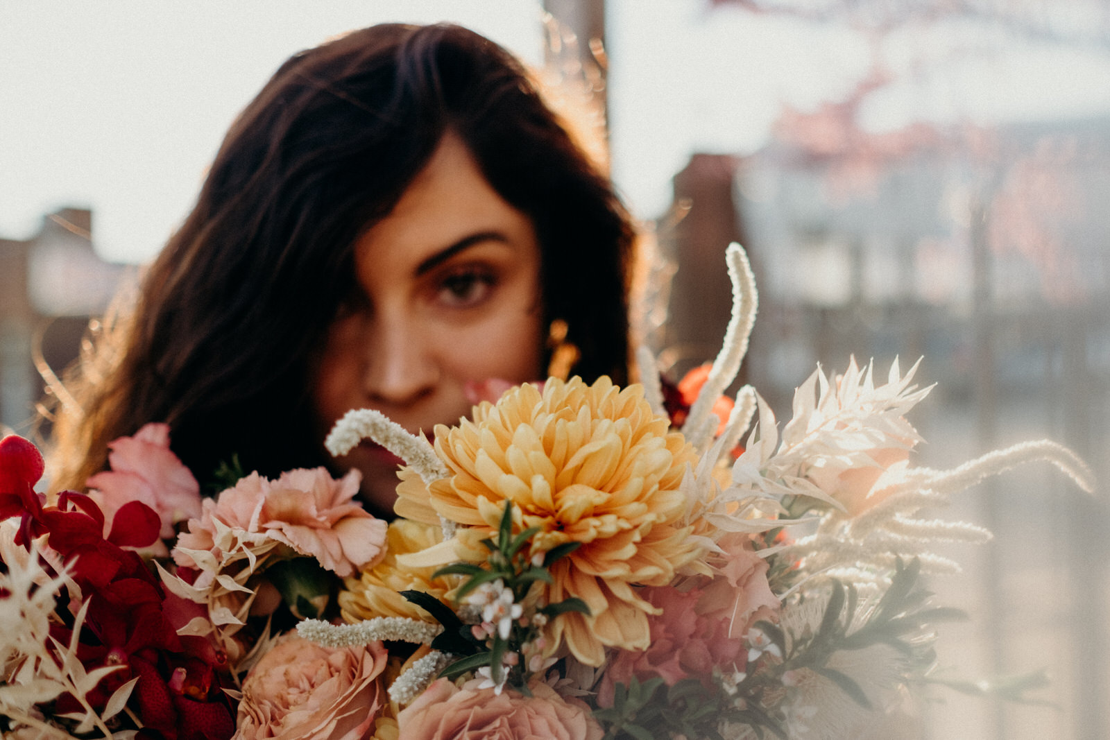 bride peeking through custom floral arrangement for kc collaboration.jpg