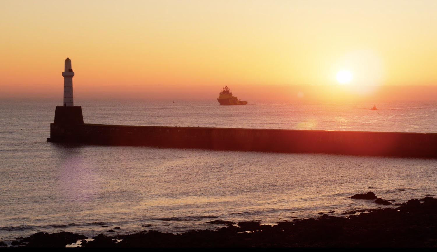 Sunrise over the breakwater at Aberdeen Harbour