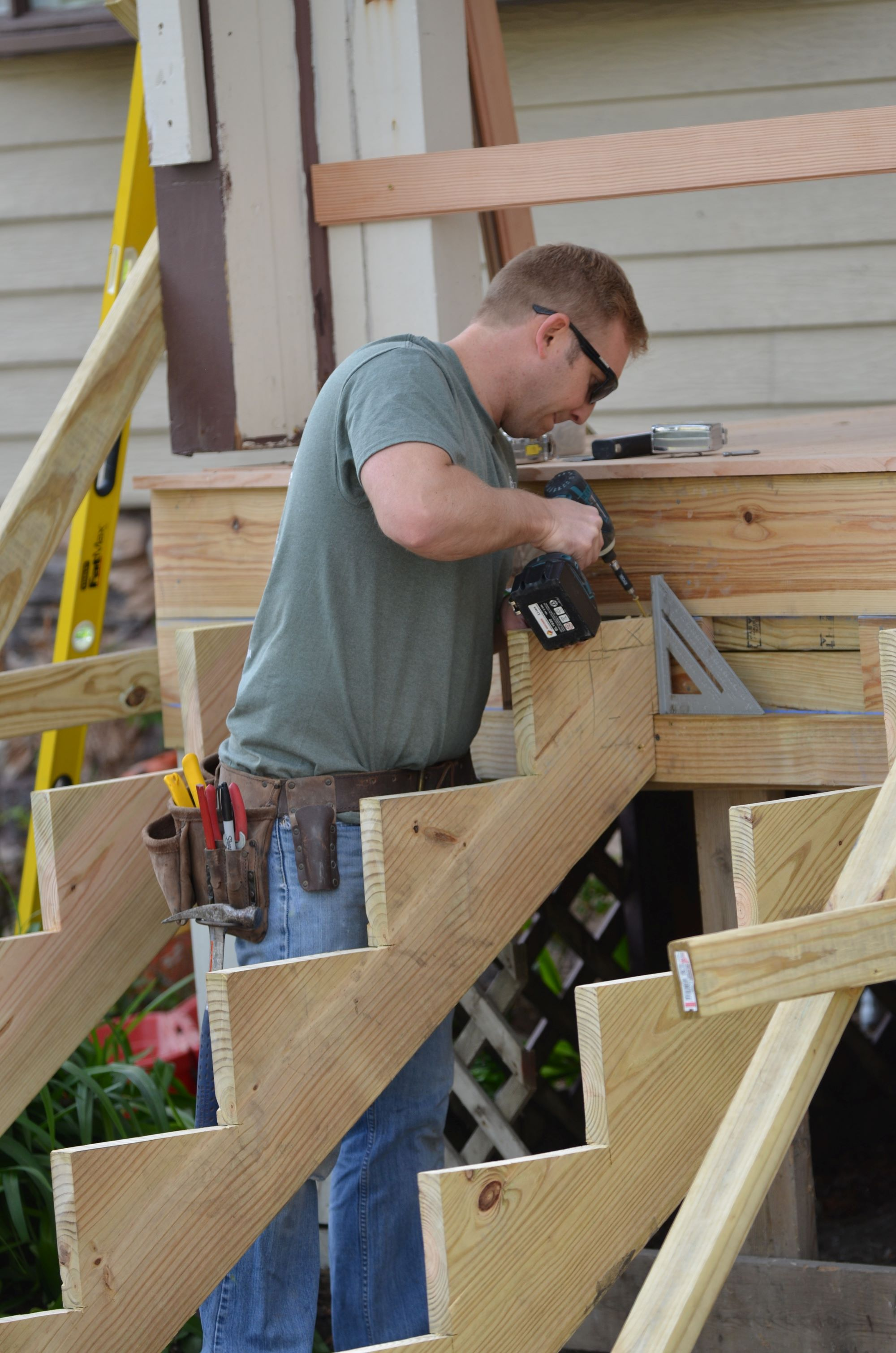 Volunteer building new steps.