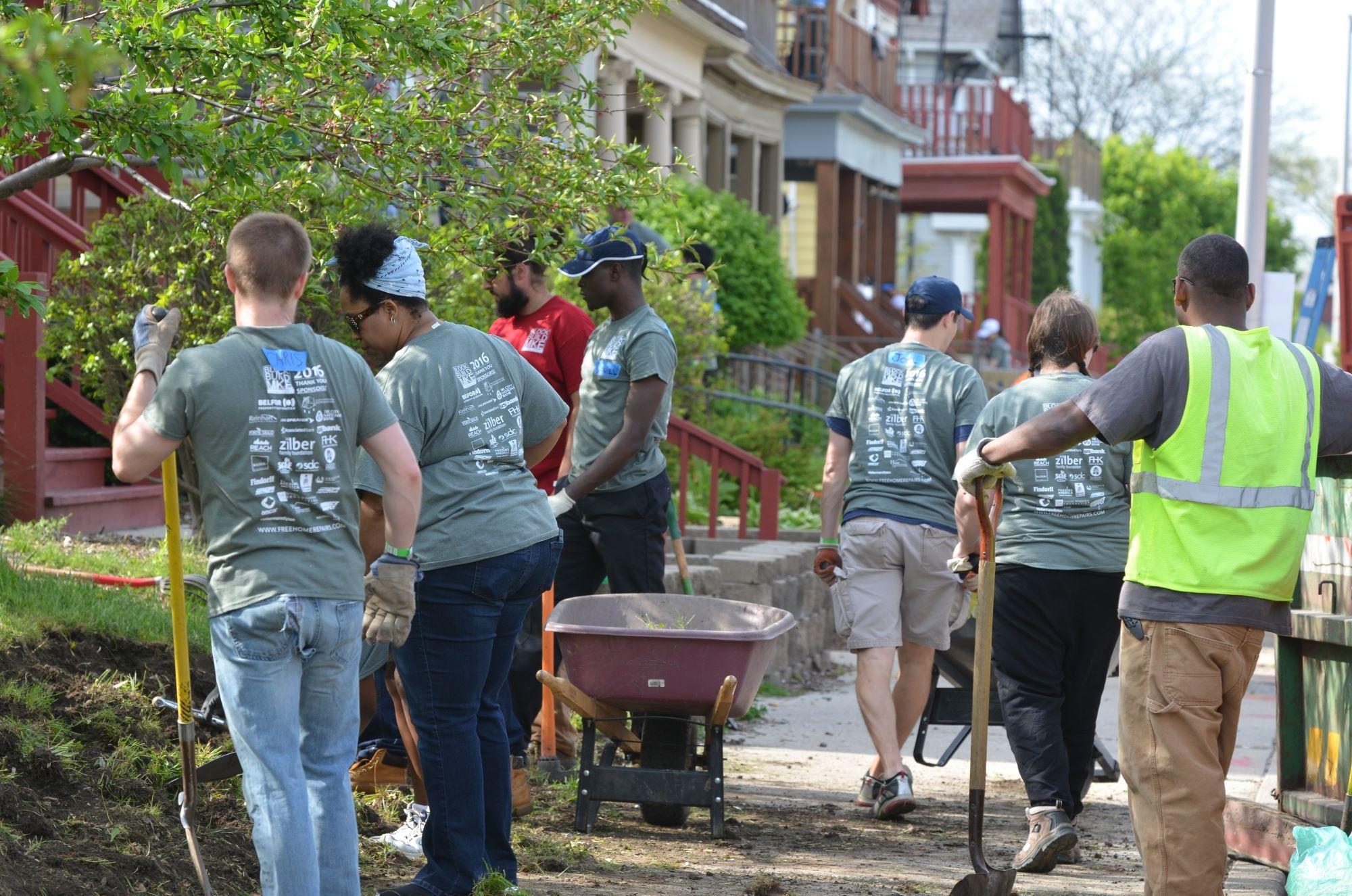 Group of volunteers landscaping.