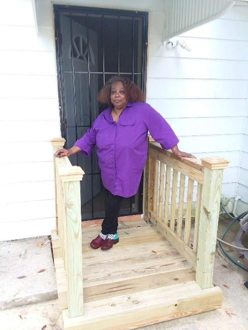 Sandra in front of her door