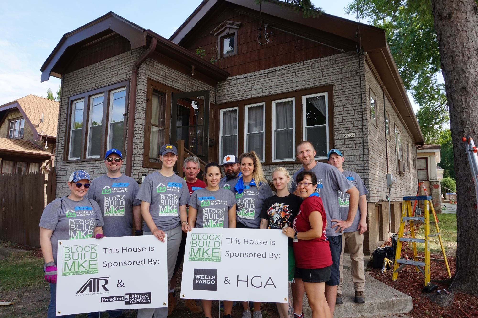 Volunteers in front of a house