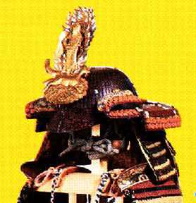 One of Kenshin's  kabuto  with a  shita-jikoro.  This one is made of  sane  attached to a fabric backing forming a three-panel skirt that defends the neck where the kasa-jikoro  won't. Note that the layers overlap in the reverse way to conventional lamination.