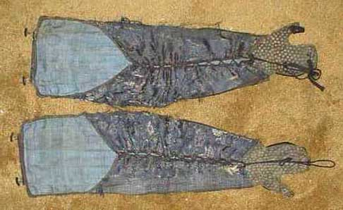 """The inside of a pair of modern  kote.  Note the leather """"lining"""" of the  tekkō  and the cord that ties the sides together."""