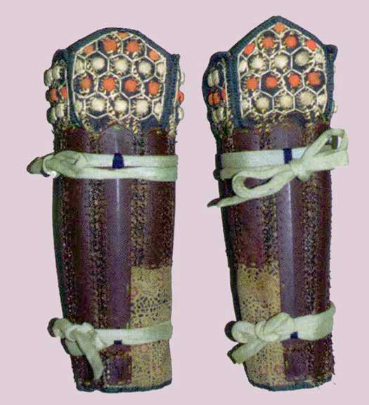 Suneate  of splint construction with sectional brigandine  tateage .  Edo period.