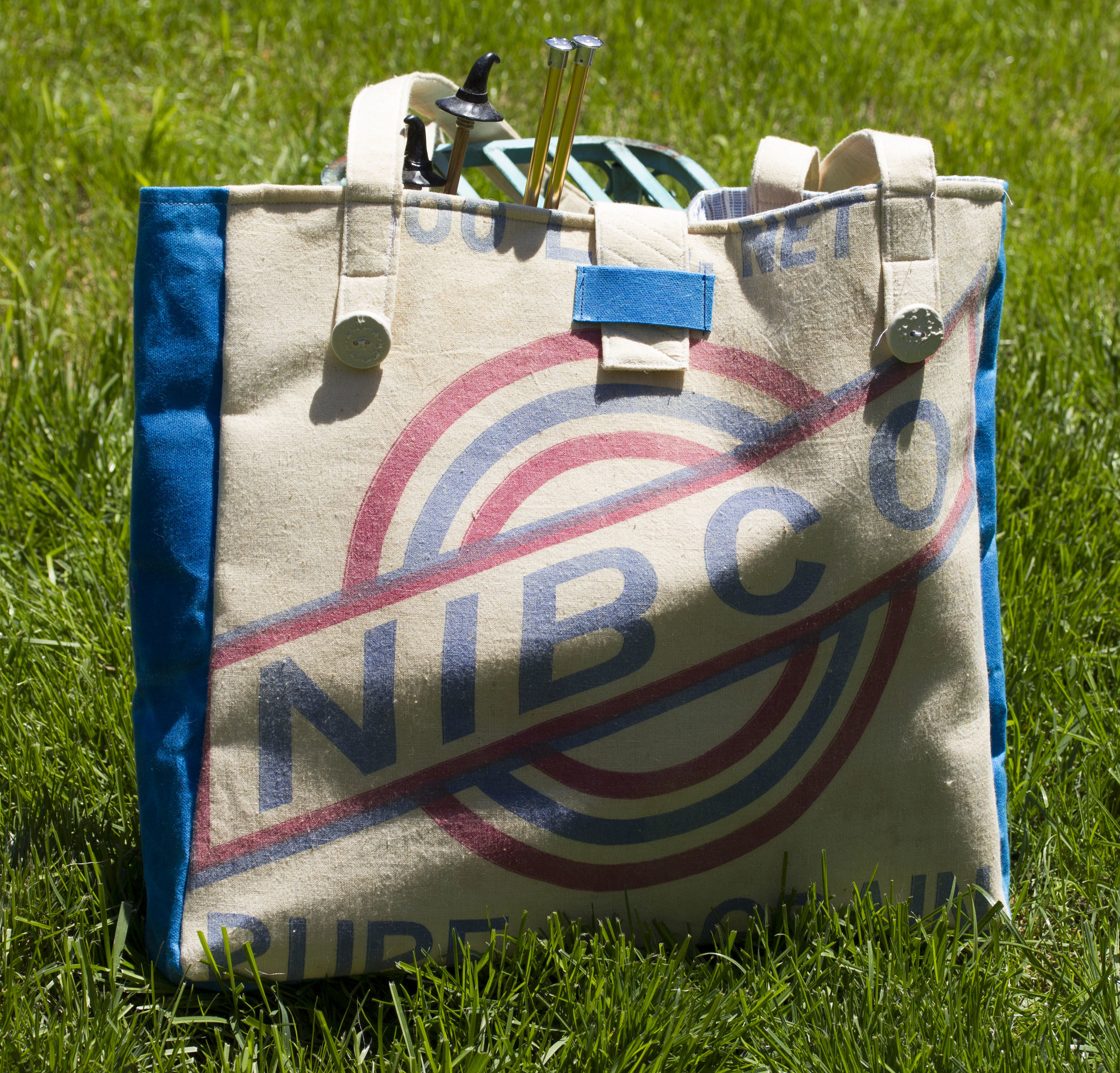Feed Sack Bag 001 - Made from an upcycled feedsack and cotton canvas, this is a one of a kind find also features handmade buttons. Make this bag yours for $100.