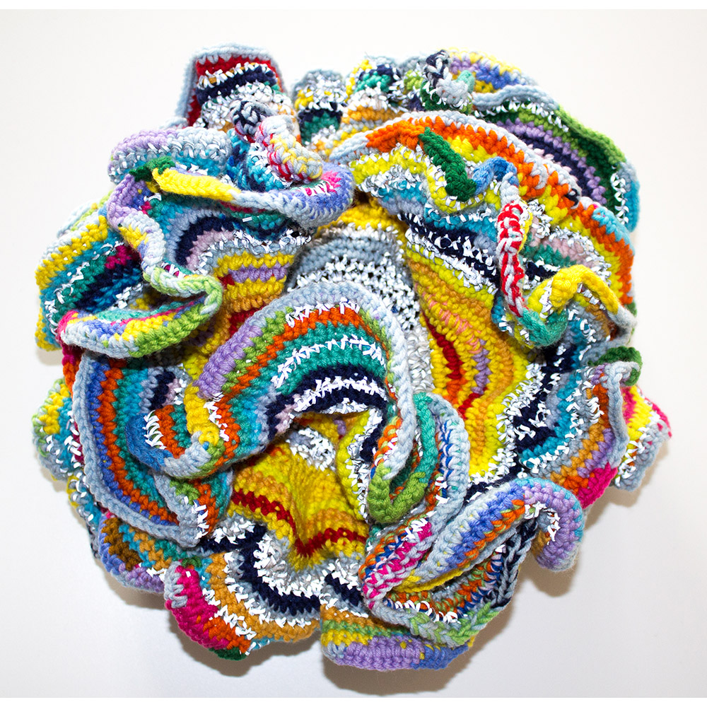 Silent Courage (2015), diameter 30 cm, merino wool and safety reflector yarn, sold