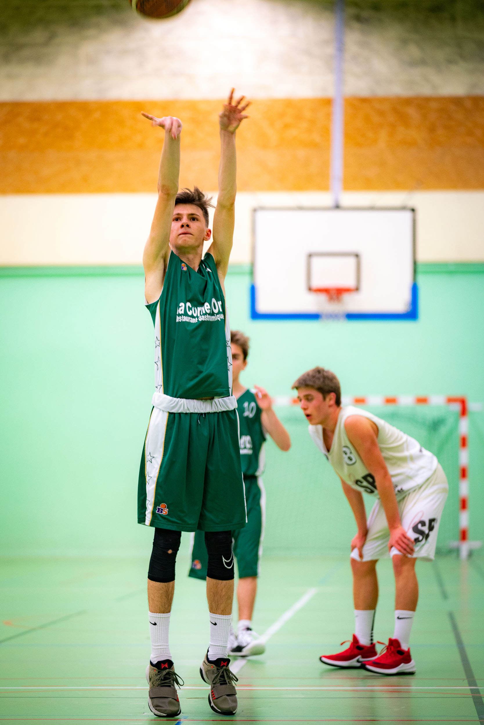 Basketball match covered by an event photographer