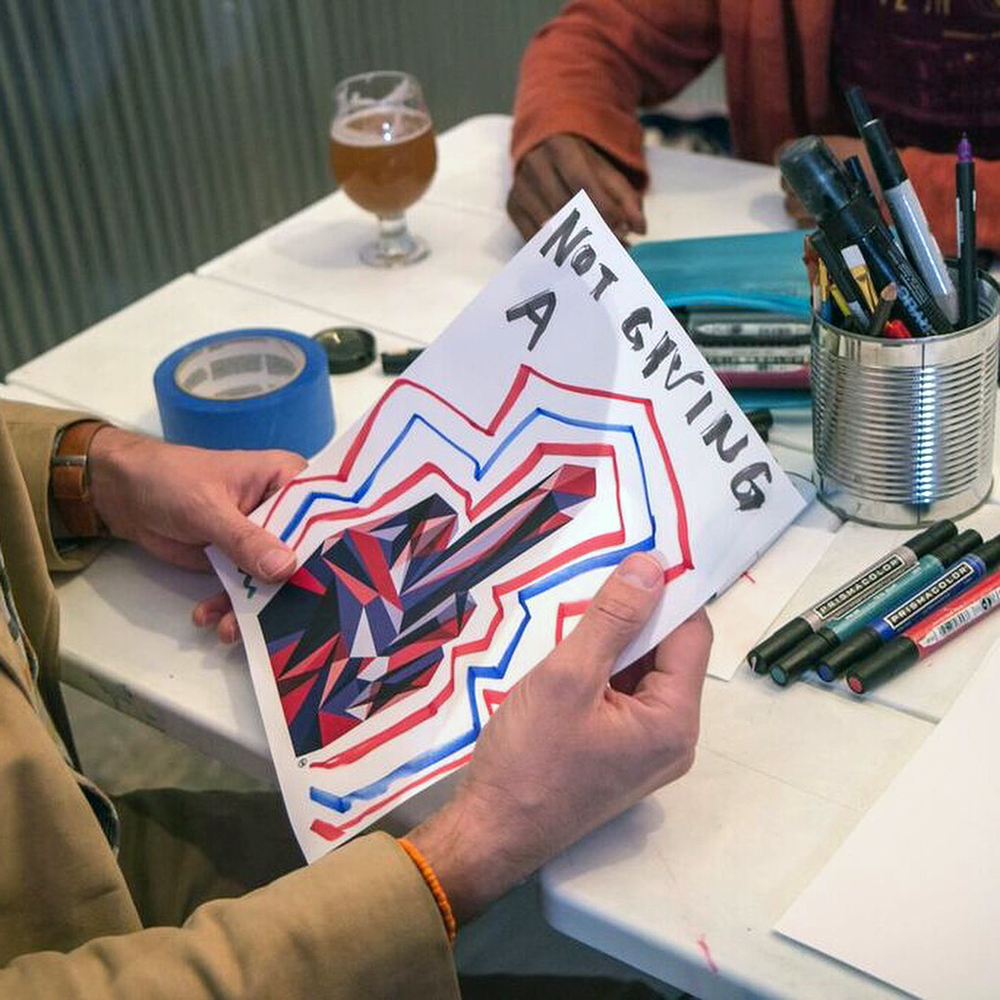 Participants write and draw on copies of an extraction of the original work, F-U-Red Blue, encouraging people to express themselves both creatively and anonymously, and then share their creation.