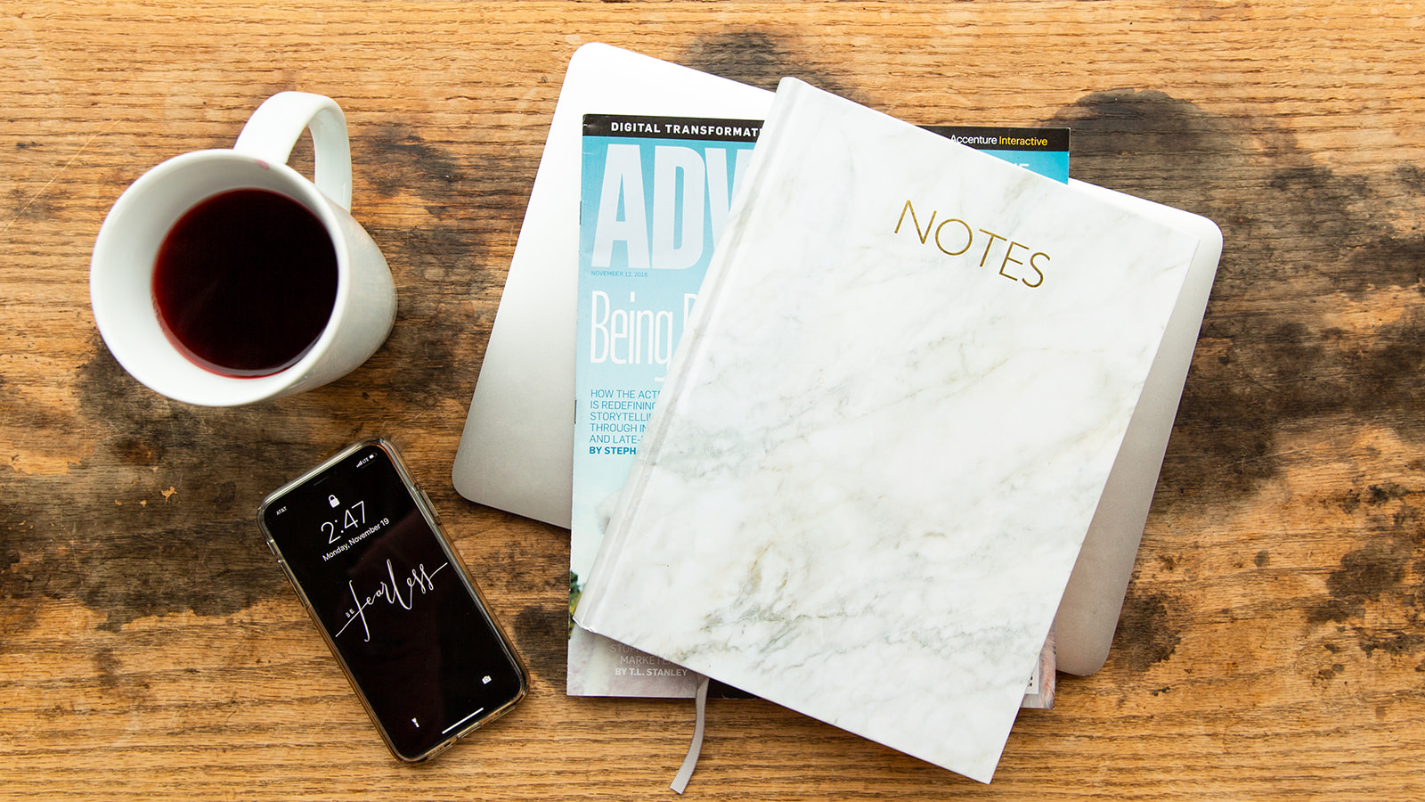 Image of notepad, Adweek magazine, an iPhone and a cup of tea from Cleveland Tea Revival.