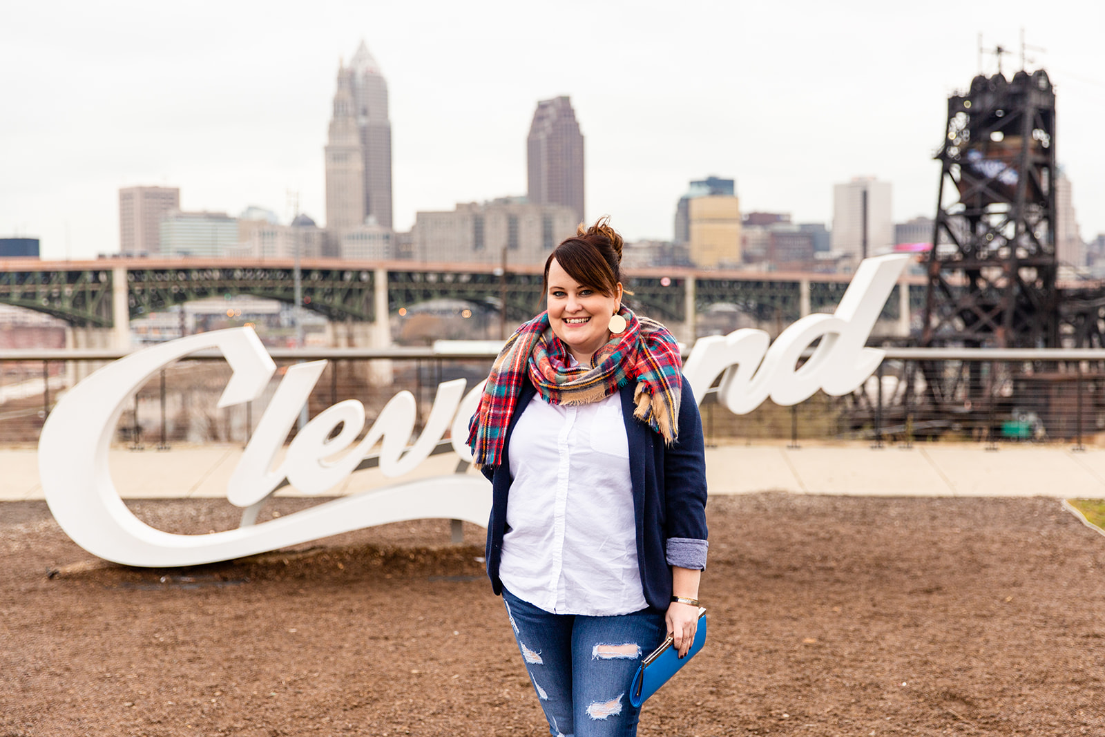 Personal branding photo of Charlene Coughlin in front of the Cleveland sign, near downtown Cleveland.