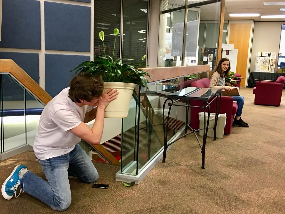 """We had to get over the fear of annoying people and break the silence,"" Junior public relations major Jake Cash said of performing a scene in the Squires Library.  By Ashley Smith, Staff Reporter"