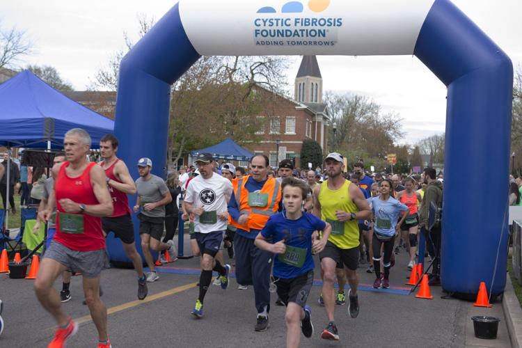 Runners in the 65 Roses 5k as they reach the finish line.  Photo by Billie Burns