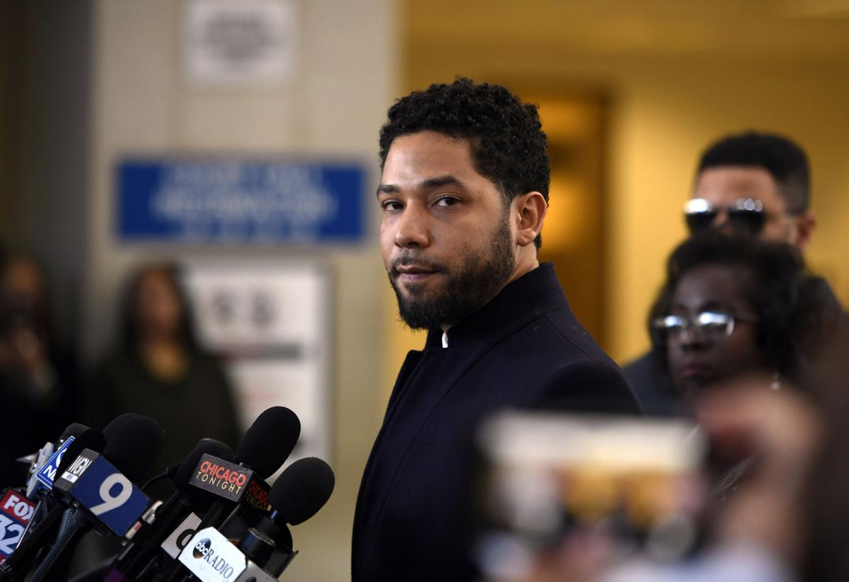 Actor Jussie Smollett talks to the media before leaving Cook County Court after his charges were dropped, Tuesday, March 26, 2019, in Chicago.  AP Photo/Paul Beaty