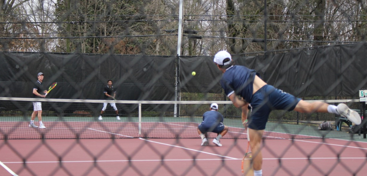 Both Flames and Lady Flames tennis teams won their matches this Saturday against Lees-McRae. With successful teamwork in both the doubles and singles matches, the teams are off to a great start this season.  Photo by Shannon Clark, Staff Reporter