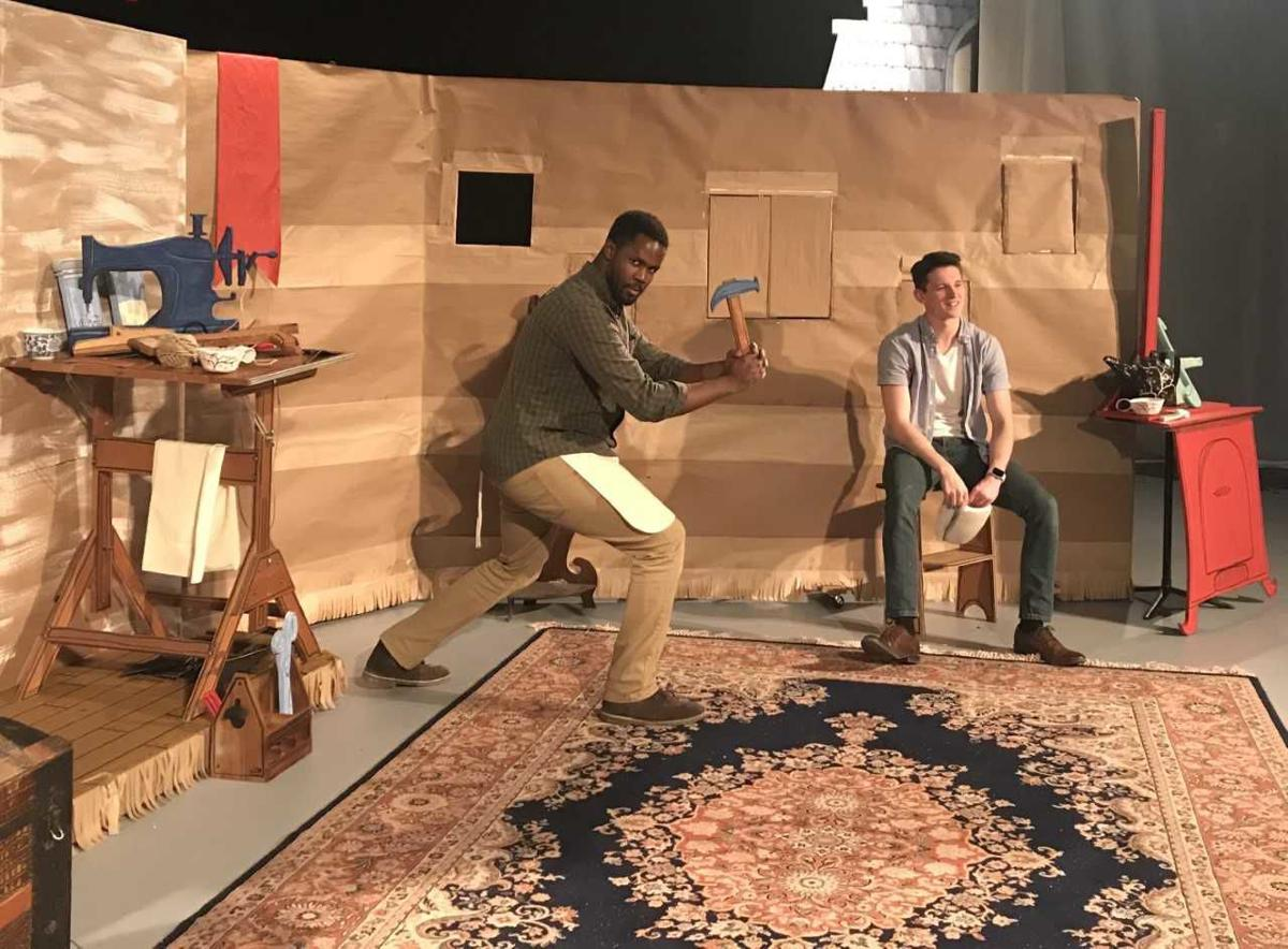 """Senior music major John Mburu, left, and junior music performance major Bryce Redick, right, on the set of """"What Men Live By.""""  Photo by Kenzie Jade, Staff Reporter"""