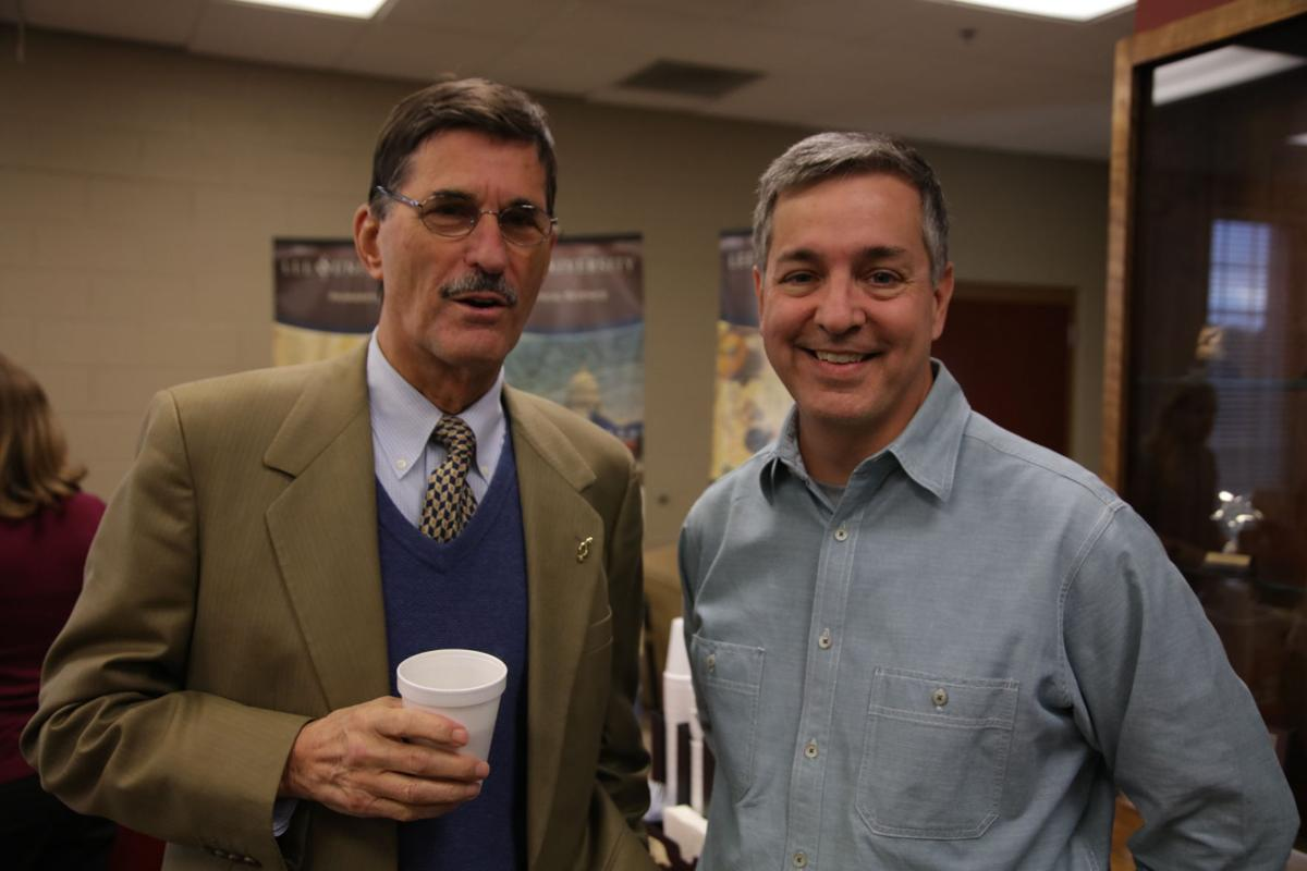 President Paul Conn (left) and Dr. John Coats (right) at Bledsoe's book premiere and reception.  Photo by John David Clark