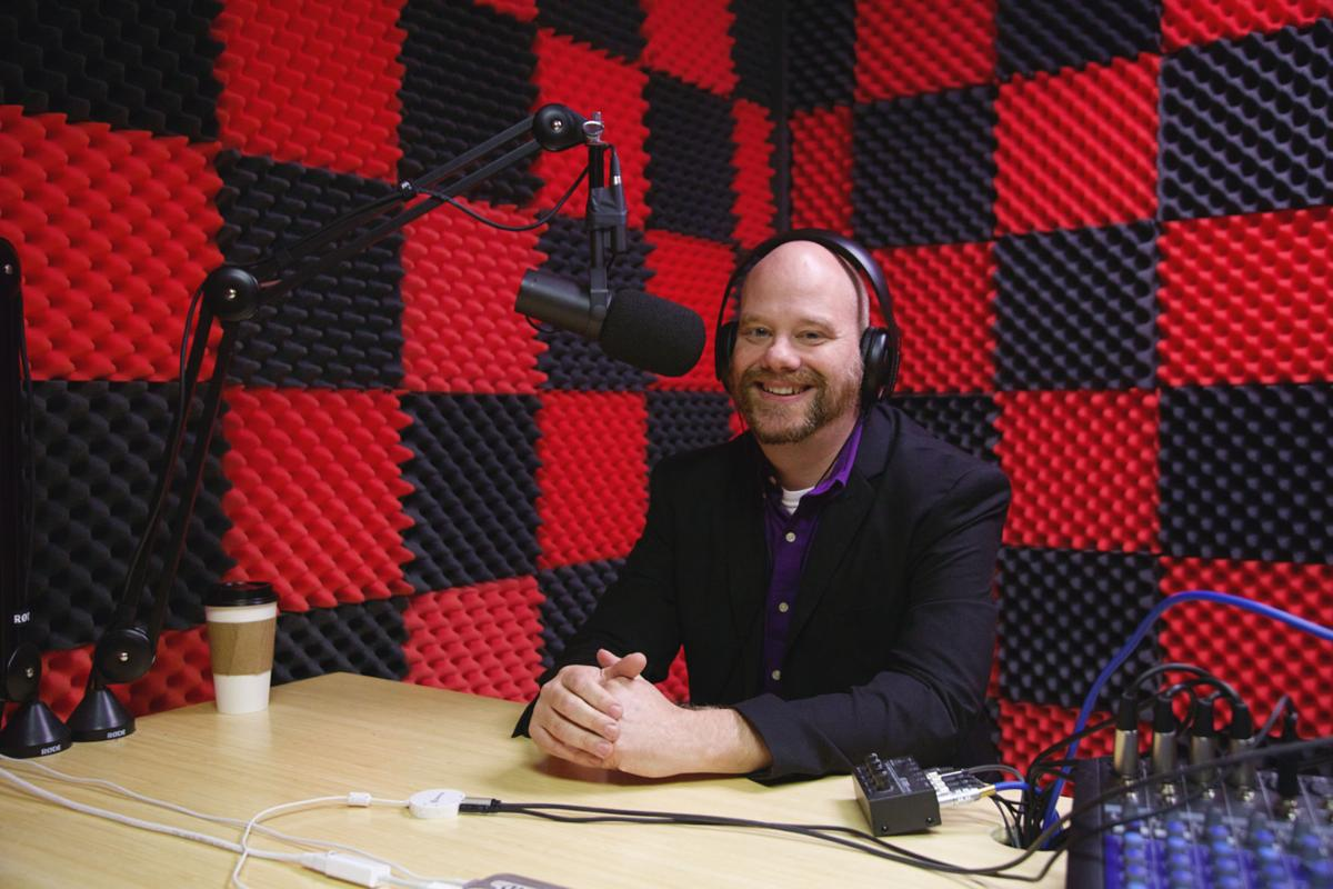 "Professor Dan Buck, co-host of podcasts ""Project SSA"" and ""The Punnery,"" in his studio.  Photo by John David Clark, Photography Editor"