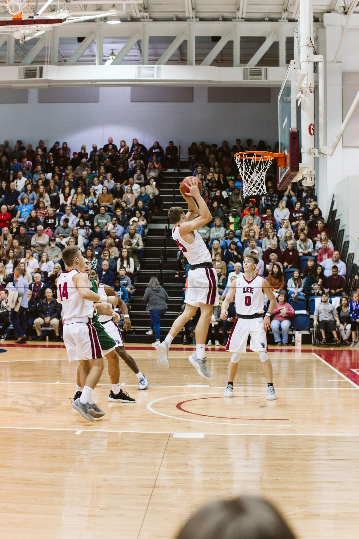 Michael McGuirk comes down with the defensive rebound against Piedmont College on Homecoming weekend.  Courtesy of Tessa Voccola, Media Services
