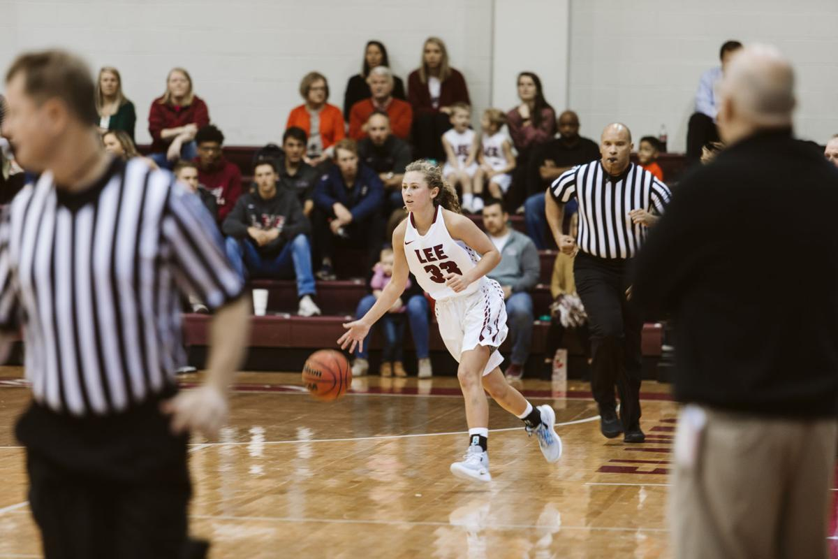 Haley Schubert dribbles down the court during the Lady Flames exhibition debut against Faulkner University.
