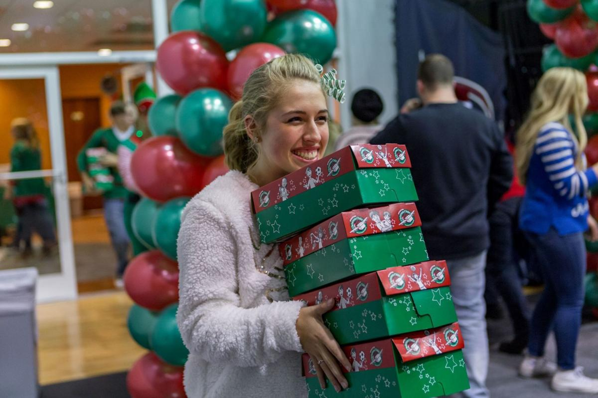 For the past 20 years, students gather in Walker Arena to pack as many shoe boxes for Operation Christmas Child as they can.  Courtesy of First Year Programs