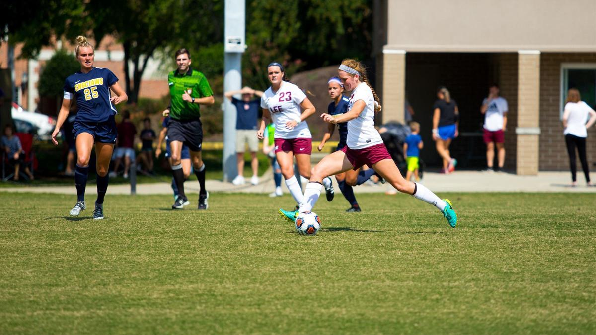 Devin Healy and Suzanne Arant take the ball down the field.  via GoLeeFlames.com