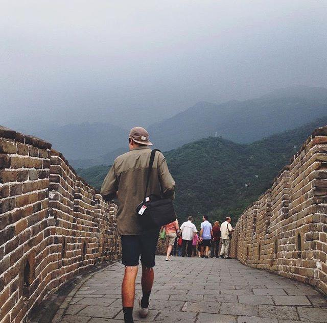 John walks the Great Wall of China, camera bag in tow.  Courtesy of John Bentley